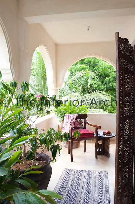 The master bedroom has its own private porch which is surrounded by lush tropical vegetation