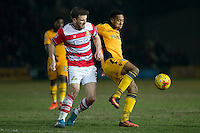Andrew Butler of Doncaster Rovers and Jaanai Gordon of Newport County during the Sky Bet League 2 match between Newport County and Doncaster Rovers at Rodney Parade, Newport, Wales on 10 February 2017. Photo by Mark  Hawkins / PRiME Media Images.