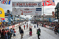 Lisbet Norris leaves the 4th avenue start line amongst the crowds during  the Ceremonial Start of the 2016 Iditarod in Anchorage, Alaska.  March 05, 2016