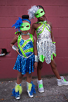 Portrait of Two Masked African American Sisters, Chinatown Seafair Parade, Seattle, WA, USA.