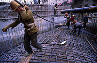 Workers at the Three Gorges Dam site in China. The dam, due for completion in about 2007, will be the biggest dam in the world.  The dam and associated infrastructural projects have been plagued with corruption and calls of an environmental catastrophe by green groups. Human rights groups say the forced relocation of upto two million people is an abuse of their basic rights..05-DEC-00