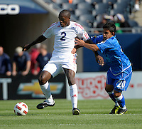 El Salvador's Andres Flores pressures Cuba's Carlos Domingo Francisco.  El Salvador defeated Cuba 6-1 at the 2011 CONCACAF Gold Cup at Soldier Field in Chicago, IL on June 12, 2011.