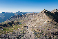 Female hiker on American Basin route to Handies peak (14053 ft), San Juan mountains, Colorado, USA