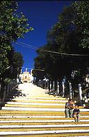 A mother and son sit on the steps of a church.  San Cristobal de las Casas, Chiapas 3-13