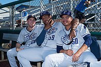 Tri-City Dust Devils pitchers Spencer Kulman (28), Jordan Guerrero (59), and Wen-Hua Sung (50) pose for a photo before a Northwest League game against the Everett AquaSox at Everett Memorial Stadium on September 3, 2018 in Everett, Washington. The Everett AquaSox defeated the Tri-City Dust Devils by a score of 8-3. (Zachary Lucy/Four Seam Images)