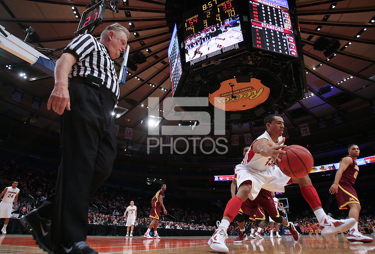 Stanford's Josh Owens (13) stops the ball from going out of bounds against Minnesota during the second half in the championship game of the NIT at Madison Square Garden, New York, N.Y., Wednesday, March 29, 2012. Stanford defeated Minnesota 75-51. (Rich Schultz/isiphotos.com)
