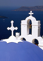 A view of the Mediterranean Sea from atop the traditional dome roof of a Greek Orthodox church. Santorini, Greece.