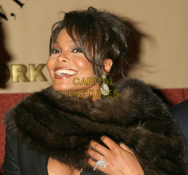 JANET JACKSON.One Hundred BlackMen 25th Annual Benefit Gala at The Hilton Towers In New York City. .November 11, 2004.headshot, portrait, fur collar, ring, earrings, jewellery, smiling, laughing.www.capitalpictures.com.sales@capitalpictures.com.© Capital Pictures