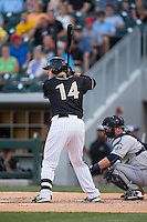 Jeremy Dowdy (14) of the Charlotte Knights at bat against the Columbus Clippers at BB&T BallPark on May 27, 2015 in Charlotte, North Carolina.  The Clippers defeated the Knights 9-3.  (Brian Westerholt/Four Seam Images)