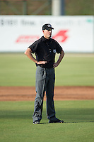 Umpire Kyle Wallace handles the calls on the bases during the South Atlantic League game between the Hagerstown Suns and the Kannapolis Intimidators at Intimidators Stadium on July 18, 2015 in Kannapolis, North Carolina.  The Intimidators defeated the Suns 1-0.  (Brian Westerholt/Four Seam Images)