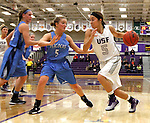 SIOUX FALLS, SD - DECEMBER 5:  Alyson Johnsen #5 from the University of Sioux Falls drives against Lindsay Carroll #5 from Upper Iowa in the first half of their game Friday night at the Stewart Center.  (Photo by Dave Eggen/inertia)