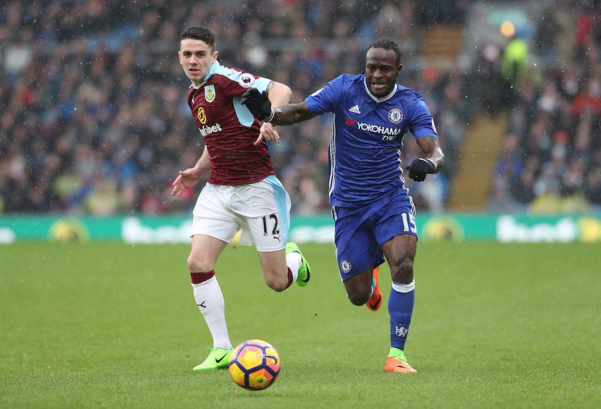 Burnley's Robbie Brady and Chelsea's Victor Moses fight for the ball<br /> <br /> Photographer Rachel Holborn/CameraSport<br /> <br /> The Premier League - Burnley v Chelsea - Sunday February 12th 2017 - Turf Moor - Burnley<br /> <br /> World Copyright &copy; 2017 CameraSport. All rights reserved. 43 Linden Ave. Countesthorpe. Leicester. England. LE8 5PG - Tel: +44 (0) 116 277 4147 - admin@camerasport.com - www.camerasport.com