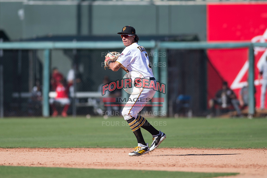 Surprise Saguaros shortstop Cole Tucker (2), of the Pittsburgh Pirates organization, prepares to make a throw to first base during an Arizona Fall League game against the Salt River Rafters on October 9, 2018 at Surprise Stadium in Surprise, Arizona. Salt River defeated Surprise 10-8. (Zachary Lucy/Four Seam Images)