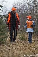 Grandfather hunting ruffed grouse with granddaughter