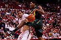 23 November 2011: Carlos Emory #33 of the Oregon Ducks fouled by Toney McCray #0 of the Nebraska Cornhuskers during the first half at the Devaney Sports Center in Lincoln, Nebraska. Oregon defeated Nebraska 83 to 76.