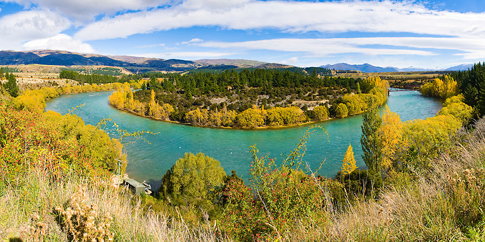 Panoramic Photo of the Clutha River, South Island, New Zealand. The Clutha River, also known as Mata Au is the second longest river in New Zealand and flows across the width of South Island, New Zealand. This panoramic photo of the Clutha River was taken just outside Queenstown, near Arrowtown.