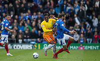 Gozie Ugwu of Wycombe Wanderers  moves past Christian Burgess of Portsmouth during the Sky Bet League 2 match between Portsmouth and Wycombe Wanderers at Fratton Park, Portsmouth, England on 23 April 2016. Photo by Andy Rowland.
