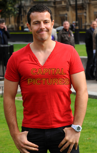 Lee Latchford Evans.Photocall for Better Breakfast Campaign,  .an initiative to encourage better breakfasting habits across the UK, Cromwell Green, London, England..September 7th, 2011.half length red v-neck t-shirt.CAP/CJ.©Chris Joseph/Capital Pictures.
