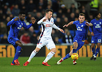 Bolton Wanderers' Adam Le Fondre under pressure from Cardiff City's Bruno Ecuele Manga (left) and Joe Ralls<br /> <br /> Photographer Kevin Barnes/CameraSport<br /> <br /> The EFL Sky Bet Championship - Cardiff City v Bolton Wanderers - Tuesday 13th February 2018 - Cardiff City Stadium - Cardiff<br /> <br /> World Copyright &copy; 2018 CameraSport. All rights reserved. 43 Linden Ave. Countesthorpe. Leicester. England. LE8 5PG - Tel: +44 (0) 116 277 4147 - admin@camerasport.com - www.camerasport.com