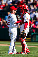 Ryan Kulik (28) of the Springfield Cardinals talks with catcher Charlie Cutler (37) during a game against the Frisco RoughRiders on April 16, 2011 at Hammons Field in Springfield, Missouri.  Photo By David Welker/Four Seam Images