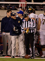 California head coach Jeff Tedford argues with the referee about a bad call during the game against Utah at Rice-Eccles Stadium in Salt Lake City, Utah on October 27th, 2012.  Utah Utes defeated California, 49-27.