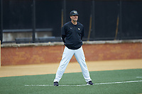 Wake Forest Demon Deacons head coach Tom Walter (16) coaches third base during the game against the Notre Dame Fighting Irish at David F. Couch Ballpark on March 10, 2019 in  Winston-Salem, North Carolina. The Demon Deacons defeated the Fighting Irish 7-4 in game one of a double-header.  (Brian Westerholt/Four Seam Images)