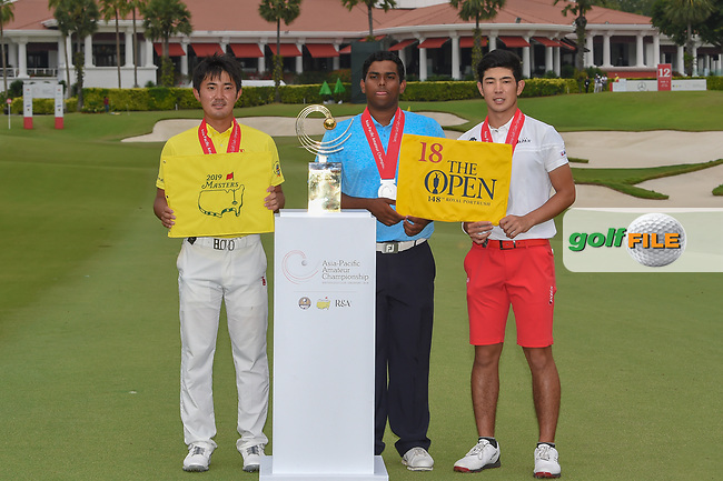 New champion, Takumi KANAYA (JPN), with co-runners up Rayhan THOMAS (IND), and Keita NAKAJIMA (JPN) following  Rd 4 of the Asia-Pacific Amateur Championship, Sentosa Golf Club, Singapore. 10/7/2018.<br /> Picture: Golffile | Ken Murray<br /> <br /> All photo usage must carry mandatory copyright credit (© Golffile | Ken Murray)