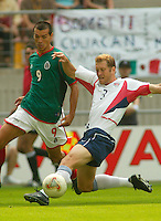 Gregg Berhalter vs. Mexico's Jared Borgetti in Jeonju, South Korea, Monday June 17, 2002. Images provided in partnership with International Sports Images. (Please credit: John Todd/Int'l Sports Images/DSA)