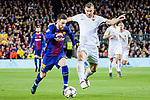 Lionel Andres Messi of FC Barcelona (L) fights for the ball with Edin Dzeko of AS Roma (R) during the UEFA Champions League 2017-18 quarter-finals (1st leg) match between FC Barcelona and AS Roma at Camp Nou on 05 April 2018 in Barcelona, Spain. Photo by Vicens Gimenez / Power Sport Images