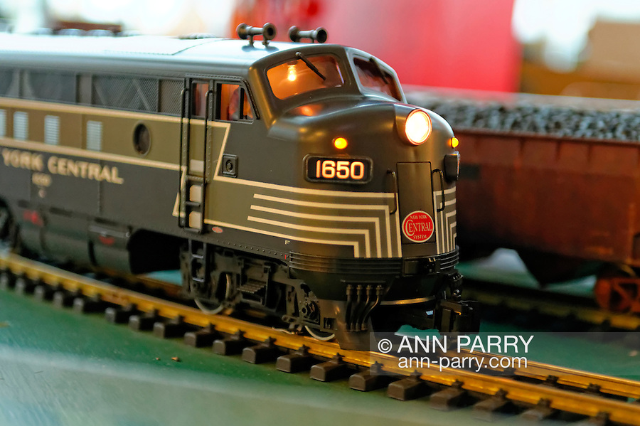 Dec. 26, 2012 - Garden City, New York, U.S. - The Long Island Garden Railway Society large-scale model train display is a festive winter holiday attraction in the vast 3-floor atrium of Cradle of Aviation museum, until shortly after New Years Day 2013. This is a close-up of G-Scale New York Central engine and a railway car carrying coal passing each other. LIGRS shares the knowledge, fun, and camaraderie of large-scale railroading both indoors and in the garden, and is family oriented.