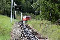 MOUNTAIN TRANSPORTATION<br /> Mount Pilatus Cog Railway Track<br /> A railway with a special toothed rack rail mounted on the railroad ties. The trains are fitted with cog wheels that mesh with the rail allowing trains to operate on inclined slopes. The Locher rack system has gear teeth on the sides of the rail.