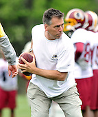 Ashburn, VA - May 2, 2009 -- Head Coach Jim Zorn instructs his quarterbacks in technique during the 2009 Washington Redskins mini-camp at Redskins Park in Ashburn Virginia on Saturday, May 2, 2008..Credit: Ron Sachs / CNP