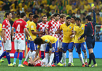 Neymar of Brazil is shown a yellow card for an apparent elbow on Luka Modric of Croatia