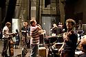 Some components of the Mahler Chamber Orchestra (MCO) grant instruments (L and R) and do stretching (C) before rehearsals in the back stage of Fraschini Theater, Pavia. © Carlo Cerchioli..Alcuni componenti della Mahler Chamber Orchestra ( MCO ) accordano gli strumenti (S e D) e fanno stretching (C) prima dell'inizio delle prove nel retropalco del teatro Fraschini, Pavia.