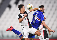 26th July 2020, Turin, Italy;  Cristiano Ronaldo and Julian Chabot grapple for the ball during the Seria A league game, Juventus versus Sampdoria