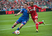 Toronto, Ontario - April 12, 2014: Colorado Rapids defender Shane O'Neill #27 and Toronto FC midfielder Issey Nakajima-Farran #20 in action during the 1st half in a game between the Colorado Rapids and Toronto FC at BMO Field in Toronto.
