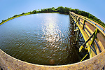 Fisheye lens view of fishing dock in marshland bay at Levy Park and Preserve, Merrick, Long Island, New York, summer 2011