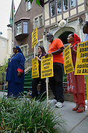 July 19, 2011 (Washington, DC)  Supporters hold signs as Akbar Muhammad, the International Representative of Louis Farrakhan and the Nation of Islam, held a press conference in front of the Embassy of Guyana, announcing a $15 million dollar lawsuit against the government of Guyana.  Mr. Muhammad alleges he was falsely detained in Guyana on May 19, 2011, for what he describes as fabricated charges of drug trafficking and terrorism.  He was later released without being formally charged.  Muhammad maintains his innocence, claiming the allegations were fabricated to tarnish his image, character and reputation.  He also sought an apology from the Guyanese government, but Bharrat Jagdeo, President of Guyana, has refused to apologize. (Photo by Don Baxter/Media Images International)