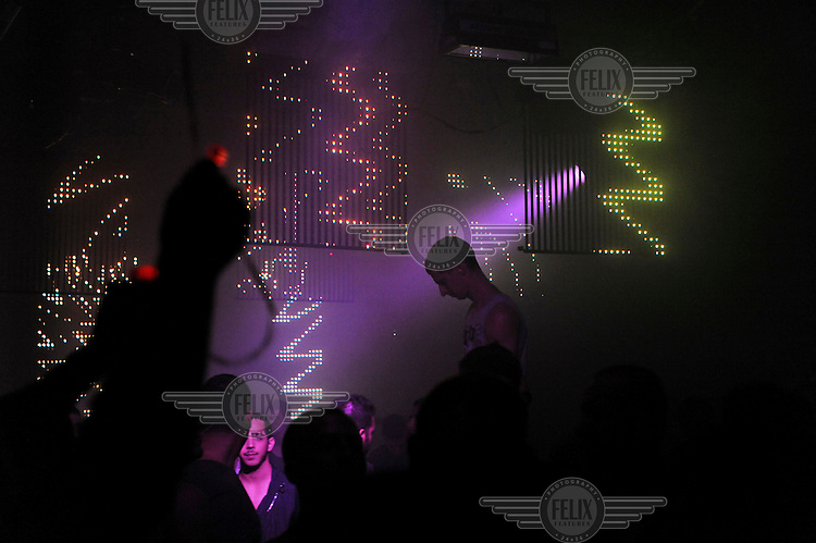 """Men in a nightclub popular with Tel Aviv's LGBT (gay, lesbian, bisexual and transgender) community. A party is being held by the gay chatline """"Pug""""."""
