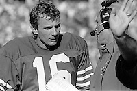 SAN FRANCISCO, CA - Quarterback Joe Montana of the San Francisco 49ers talks to coach Bobb McKittrick during a game against the St. Louis Cardinals at Candlestick Park in San Francisco, California in 1986. Photo by Brad Mangin