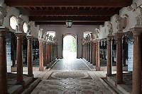 The stable is divided into 32 stalls, 16 on each side, punctuated with grand columns of red marble dividing the space, topped with individually crafted cherubs