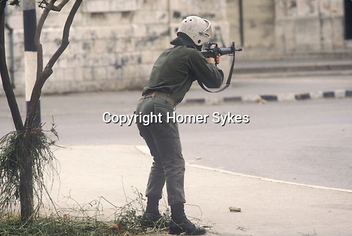 Nablus West Bank Israel. Israeli soldier shoots at rioting Palestinians 1980s Middle East