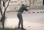 Nablus West Bank Israel. Israeli soldier shoots at rioting Palestinians 1980s Middle East