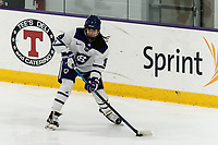 WORCESTER, MA - FEBRUARY 08: Bailey Bennett #8 of Holy Cross passes the puck during a game between Boston University and College of the Holy Cross at Hart Center Rink on February 08, 2020 in Worcester, Massachusetts.