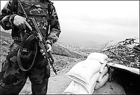 Between Serbia and east Kosovo.  A young soldier keeps guard from the potential threat of Albanian terrorists. near Vranje, Serbia, Yugoslavia, May 2001 &copy; Stephen Blake Farrington&amp;#xA;<br />