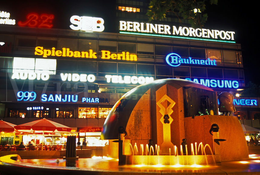 Berlin, Germany, Europe, Europa-Center illuminated with neon lights in the evening in downtown Berlin.