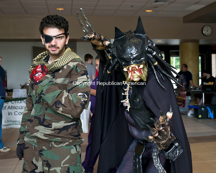 """Waterbury, CT- 26 July 2015-072615CM10-  Social moments from left,  Anthony Izzi of Bethlehem as Big Boss and Tim Wylie of Westfield, MA as """"Preda-Bat"""" are photographed during the sixth annual Brass City Comic Convention at Naugatuck Valley Community College in Waterbury on Sunday. Proceeds from the event will benefit Safe Haven of Greater Waterbury.  Christopher Massa Republican-American"""