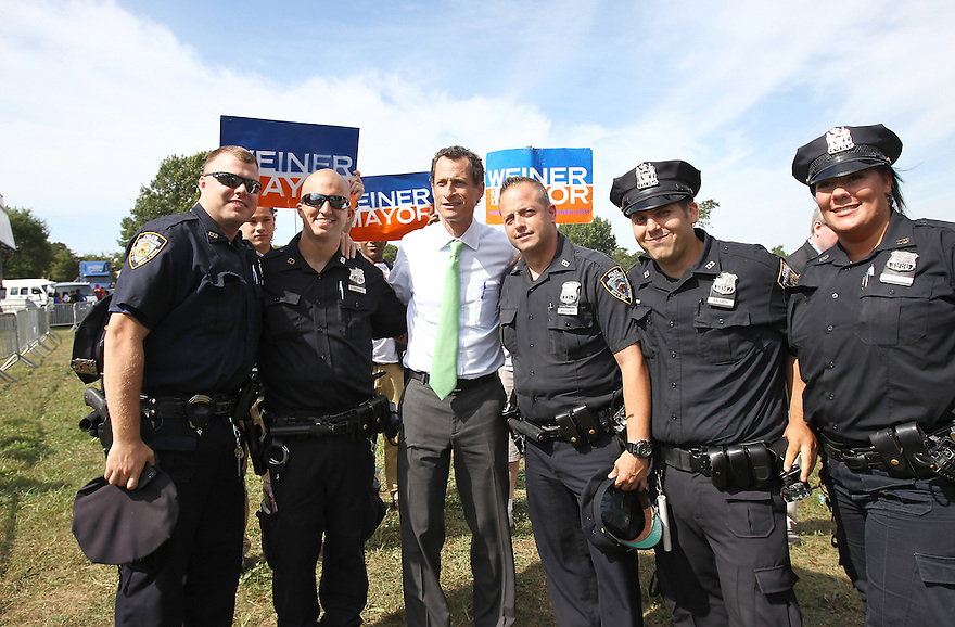 Mayoral candidate Anthony Weiner pose for a photo while making a campaign stop at Roy Wilkins Park on Saturday, Sept. 7, 2013 Queens, New York. (AP Photo/ Donald Traill)