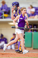 One of the LSU Tigers bat girls runs off the field during the game against the Wake Forest Demon Deacons at Alex Box Stadium on February 20, 2011 in Baton Rouge, Louisiana.  The Tigers defeated the Demon Deacons 9-1.  Photo by Brian Westerholt / Four Seam Images