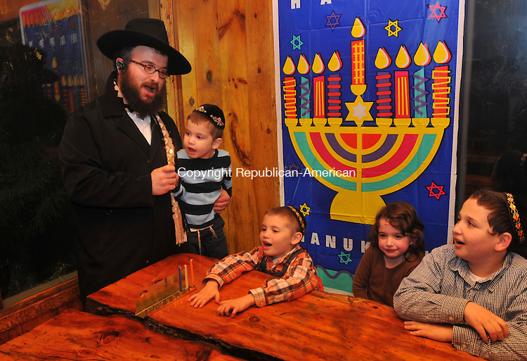 WOODBURY, CT-13 DECEMBER 2009-121309IP06- (l to r) Rabbi Joseph Eisenbach of Litchfield and his children Shmuel, 3, Menachen, 8, Chana, 5, and Nochum, 10, sing a song before lighting the menorah at Woodbury Ski Area in Woodbury during what was supposed to be the Chanukah on the Slopes event. Not many people showed up due to the inclement weather.<br /> Irena Pastorello Republican-American